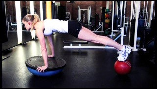 Picture of a female doing Upside Down Bosu Plank Exercise