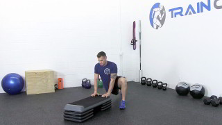 dynamic hip mobility on steps - step 2