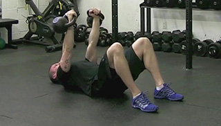 double kettlebell floor press - step 2