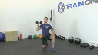 Picture of a male doing Kneeling Dumbbell Shoulder Press Exercise