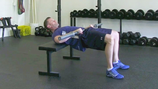 weighted glute bridge on bench - step 1