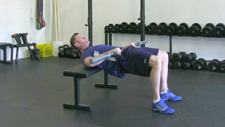 weighted glute bridge on bench - step 3