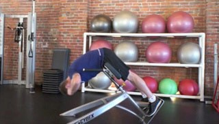Picture of a male doing Back Extention Exercise