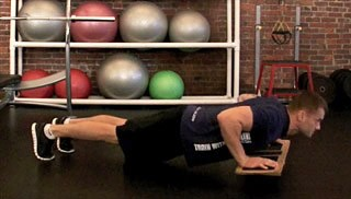 Picture of a male doing Balance Board Push Up Exercise