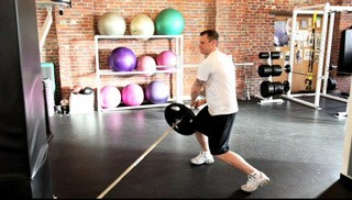 Picture of a male doing Barbell Trunk Twist Exercise