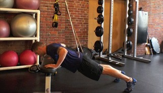 Picture of a male doing Bench Push-Ups Exercise