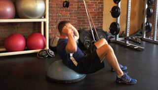 Picture of a male doing Bosu Ab Crunch Exercise
