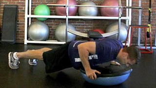 Picture of a male doing Bosu Push-Up Exercise