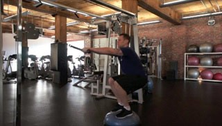 Picture of a male doing Bosu Squat and Row Exercise