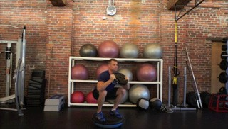 Picture of a male doing Bosu Squat Press Exercise