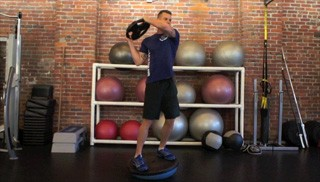 Picture of a male doing Bosu Woodchops Exercise