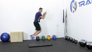 broad jumps over mat - step 2