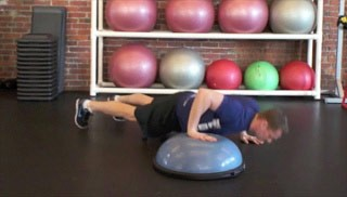 Picture of a male doing Cross Over Push-Ups Exercise