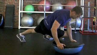 Picture of a male doing Cross Unders on Bosu Exercise