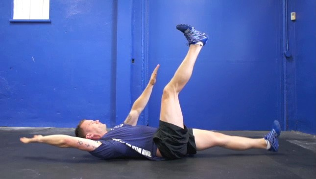 Picture of a male doing Deadbugs Intermediate Exercise