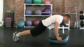 double bosu knee tucks - step 1