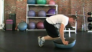 double bosu knee tucks - step 2