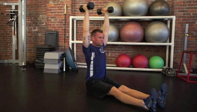 Picture of a male doing Dumbbell Sit-Ups Exercise