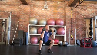 Picture of a male doing Dumbbell Thrusters Exercise