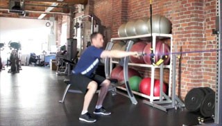 exercise band squat row - step 1