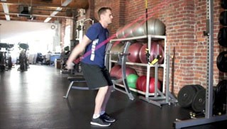 Picture of a male doing Exercise Band Straight Arm Pulldowns Exercise