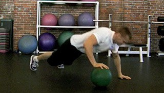 Picture of a male doing Explosive Medicine Ball Push Ups Exercise