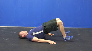 Picture of a male doing Glute Bridges Exercise