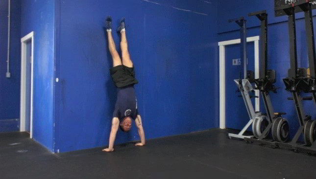 hand stand against wall - step 3
