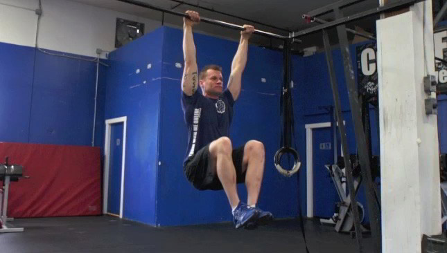 hanging knee tuck hold - step 1