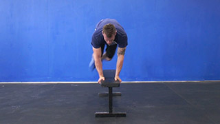 Picture of a male doing Hop Overs on the Bench Exercise