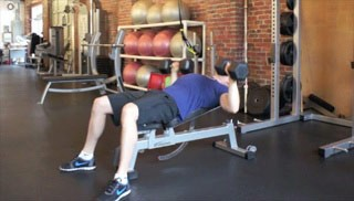 Picture of a male doing Incline Chest Press Exercise