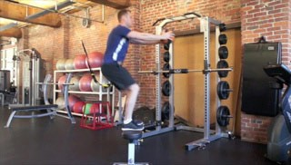 Picture of a male doing Jump Ups on Bench with Medicine Ball Exercise