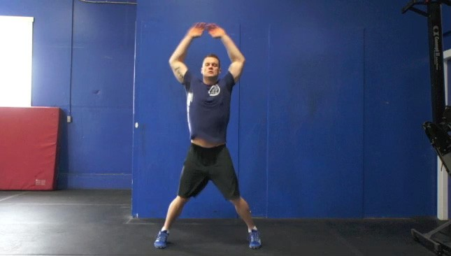 Picture of a male doing Jumping Jacks Exercise