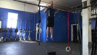 Picture of a male doing Jumping Pull-Ups Exercise