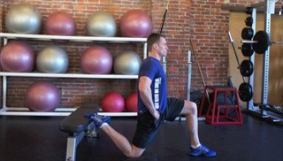 kneeling hip flexor stretch on bench - step 1