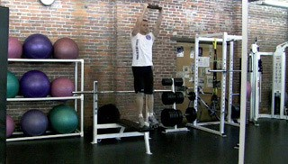 Picture of a male doing Lateral Shuffle on Bench with Press Exercise