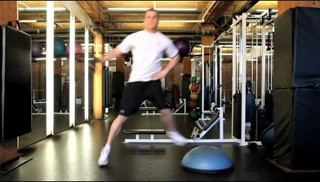 Picture of a male doing Lateral Shuffle Side Raise on Bosu Exercise