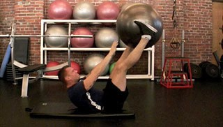 Picture of a male doing Leg Drop Crunch w/ Stability Ball Exercise
