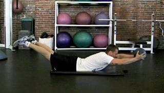 Picture of a male doing Light Medicine Ball Chest Raises Exercise