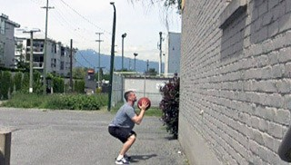 med ball squat throws - step 3