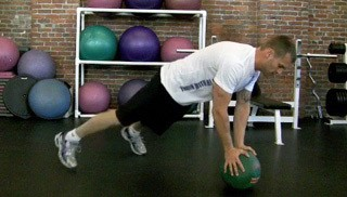 Picture of a male doing Med Ball Toe Taps  Exercise