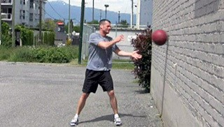 Picture of a male doing Med Ball Wall Throws Exercise