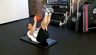 Picture of a male doing Medicine Ball Crunch-Ups Exercise