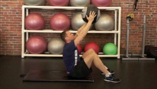 Picture of a male doing Medicine Ball Crunch Exercise