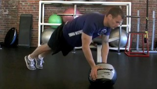 medicine ball double toe taps - step 1