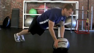 medicine ball double toe taps - step 3