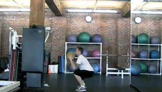 medicine ball squat pass - step 1