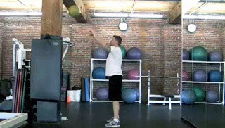 Picture of a male doing Medicine Ball Squat Pass Exercise