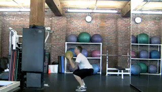 medicine ball squat pass - step 3