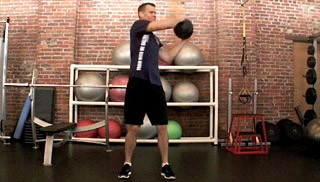 Picture of a male doing Medicine Ball Woodchops Exercise
